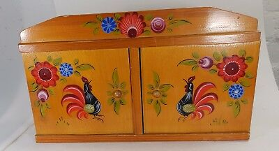 Small ornate wooden box with cockral design on front