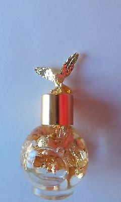 Bottle of Gold Flakes- Genuine Gold in Bottle- Gold color eagle . Decorative