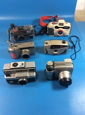 Lot of 6 - Mixed models and makes of older cameras - Canon, Olympus, Kodak - tc