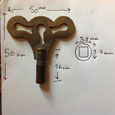 old mechanical clock key