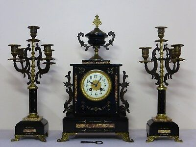 antique French marble 8 day chime mantle clock with candelabras. good working.