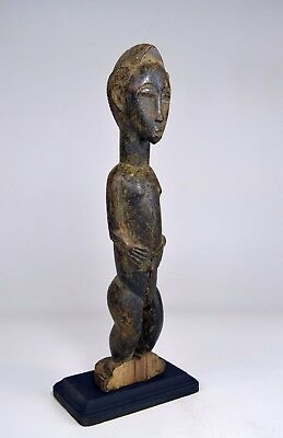 A weathered Old Baule Male Spirit Husband sculpture, African Art
