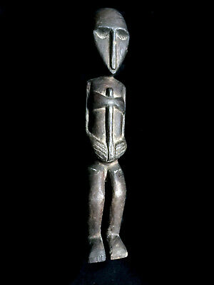 super... old warrior figure with 'stone' axe TIMOR Indonesia