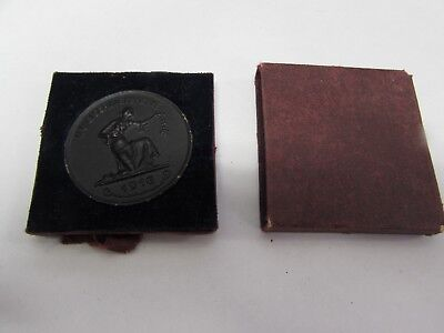 WWI German black coin in case for giving gold to the war effort.