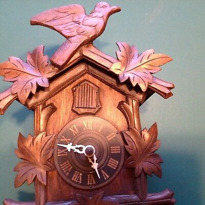 old black Forrest cuckoo clock for spares repairs retoration.