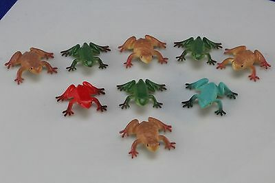9 Frog Figures Including Two Poison Colored Frogs.