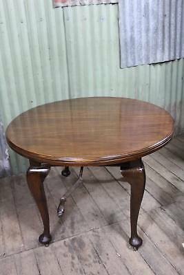 An Antique Circular Extension Table with One Leaf and Winder