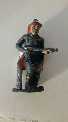 Vintage Barclay Lead Toy Figure - Fireman Carrying Hose