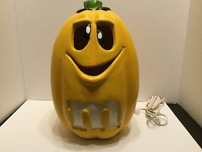 M & M candies collections yellow lighted pumpkin