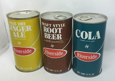 Three Riverside Soda Cans