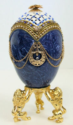 Russian Replica Faberge egg featuring a Dynasty Blue Egg