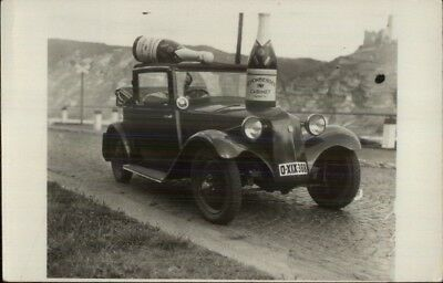 Wine or Champagne Giant Schonberger Cabinet Bottles on Old Car RPPC adv