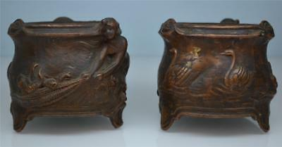 a pair of very unusual art nouveau 19thC relief metal work fisher girl vases