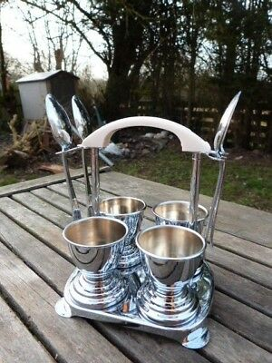 Vintage Art Deco Chrome & Bakelite Set Of Four Egg Cups On Stand With Spoons.