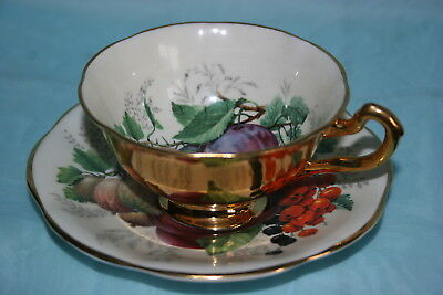 Gorgeous Vintage Rosina china cup saucer set - Gold with Fruits