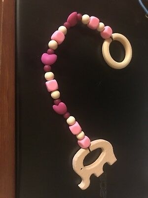 Teething Toy Made From Silicone Beads And Natural Wood Products