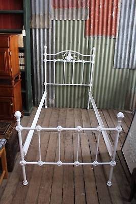 A White Cast Iron Single Bed in the Victorian Manner