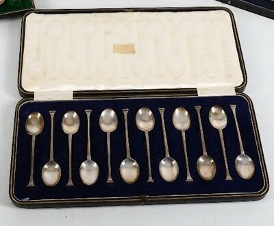 A cased set of 12 Solid Silver teaspoons in Arts & Crafts style 1921 VGC