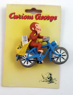 Curious George on bicycle delivering newspapers c1997 jewelry pin