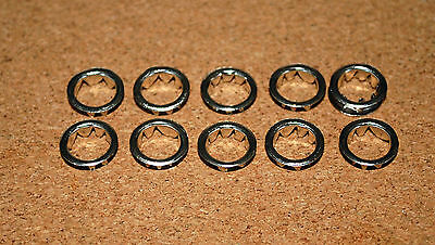 TEN NICKEL /SILVER  CLOCKFACE / KEYHOLE  GROMMETS. 10mm FREE POSTAGE. BARGAIN!!