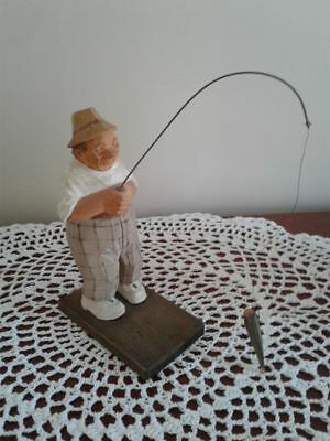 Fisherman C.O. TRYGG wood carved figure with his catch of the day