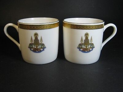 Two Small Patra Coffee Cups With Gilded Gold Emblems  .dr