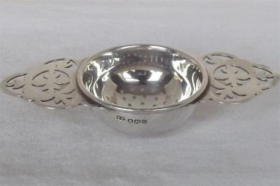A Superb Solid Sterling Silver Twin Handled Tea Strainer Sheffield 1950.