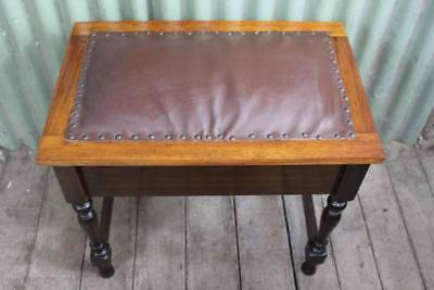 A Vintage Blackwood Piano Stool with Lift Top Seat