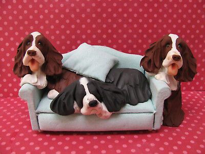 Handsculpted L/W and B/W English Springer Spaniel Dogs on Sofa Figurine