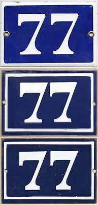 Old blue French house number 77 door gate wall fence street sign plate plaque