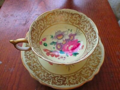 Paragon cup & saucer yellow & gold with flowers