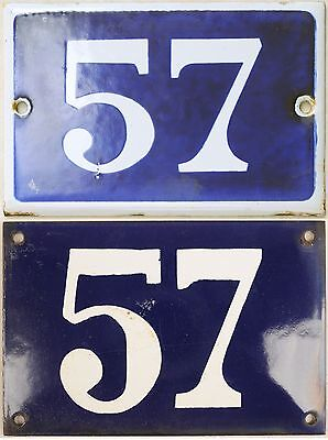 Old blue French house number 57 door gate wall fence street sign plate plaque