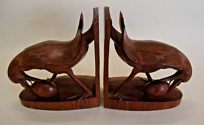 Early 20th century pair of South-East Asian made carved wood book ends of birds