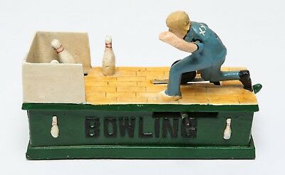 """Cast Iron Mechanical Coin Bank, """"Bowling Alley"""""""