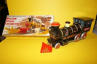 "RF32 39 TRADE MARK MODERN TOYS  Blechlokomotive  "" WESTERN "" in OVP"