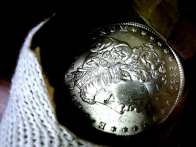 1885-o Blast White Unc Morgan Silver Dollar from a fresh Roll Will Grade Out