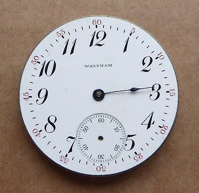 Elgin pocket watch dial with part steel movement, 43mm, 5 minute numbers in red.