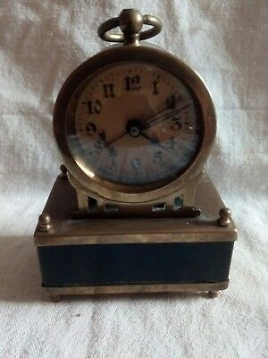 antique minature alarm clock for spares or repairs.
