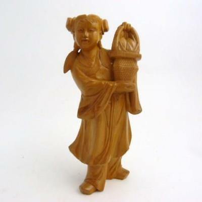 CHINESE CARVED WOOD FIGURE OF A YOUNG GIRL CARRYING A FLOWER BASKET, 1920's/30s