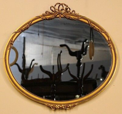 Antique Georgian gilt carved oval ribbon top mirror gold gilt carved swags 1900s