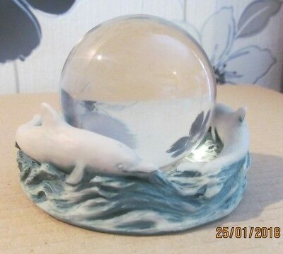 Dolphin stand with crystal ball