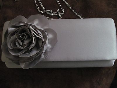 Silver colored evening purse with flower and drop chain by Lulu Townsend
