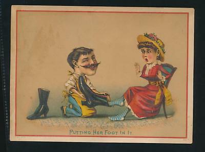 """Victorian trade card, GREAT SHOE CARD, """"Putting Her Foot in it"""""""