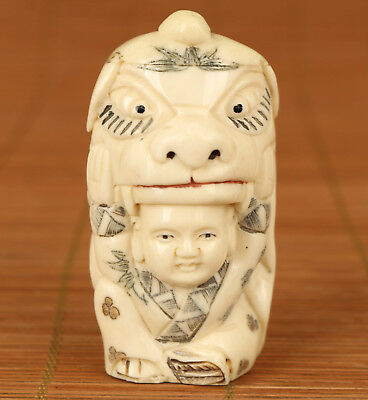 Rare Chinese Old 0.x-b.0ne Hand Carved lion dance Statue Netsuke