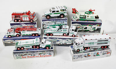 Lot Of 7 Hess Toy Trucks Helicopter Race Cars