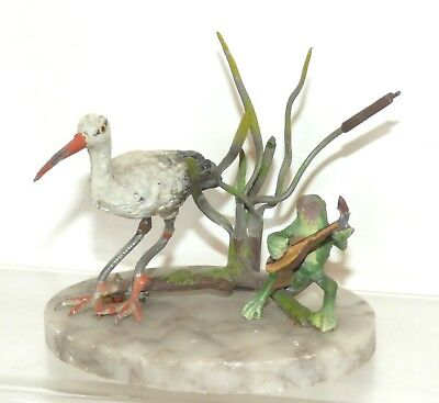 GT02 - Heyde Germany ? Singing Frog and Stork on marble base. Reed 64mm high VGC