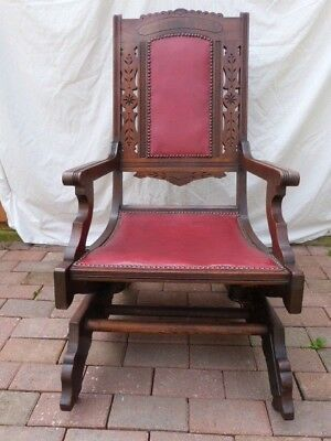 Lovely Antique Hand Carved Mahogany Upholstered American Rocker Rocking Chair.