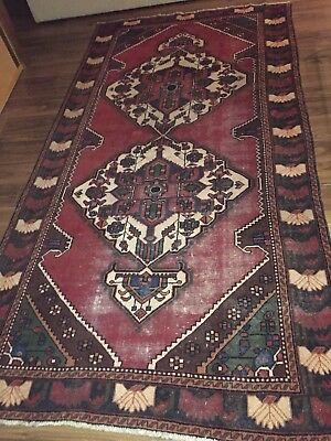 An antique Baktiari Persian rug 152cms+300cms purchased in auction