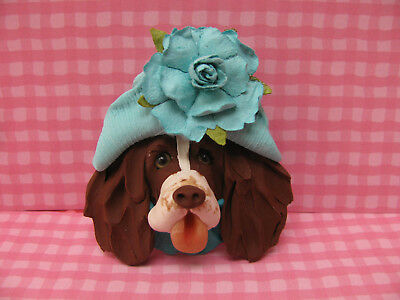 Handsculpted L/W English Springer Spaniel in Aqua Hat with Flower Lapel Pin