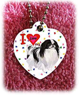 "Japanese Chin Dog heart necklace 24"" chain background of hearts"